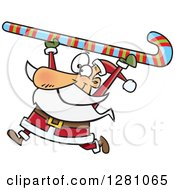 Clipart Of A Happy Santa Clause Carrying A Giant Christmas Candy Cane Over His Head Royalty Free Vector Illustration