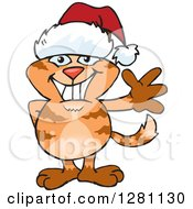 Clipart Of A Friendly Waving Siamese Cat Wearing A Christmas Santa Hat Royalty Free Vector Illustration by Dennis Holmes Designs