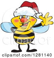 Clipart Of A Friendly Waving Bee Wearing A Christmas Santa Hat Royalty Free Vector Illustration