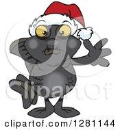 Clipart Of A Friendly Waving Black Moor Fish Wearing A Christmas Santa Hat Royalty Free Vector Illustration by Dennis Holmes Designs