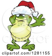 Clipart Of A Friendly Waving Bullfrog Wearing A Christmas Santa Hat Royalty Free Vector Illustration by Dennis Holmes Designs