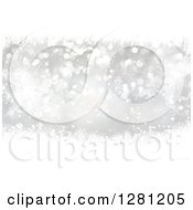 Clipart Of A Silver Christmas Background Of Tinsel Snowflakes And Bokeh Flares Royalty Free Illustration
