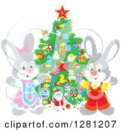 Clipart Of Cute Festive Rabbits By A Christmas Tree Royalty Free Vector Illustration