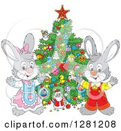Clipart Of Cute Gray Festive Rabbits By A Christmas Tree Royalty Free Vector Illustration