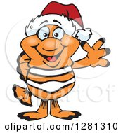 Clipart Of A Friendly Waving Clownfish Wearing A Christmas Santa Hat Royalty Free Vector Illustration by Dennis Holmes Designs