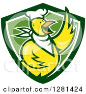 Clipart Of A Cartoon Yellow Chef Chicken Waving Over A Green And White Shield Royalty Free Vector Illustration