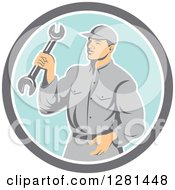 Clipart Of A Retro Male Mechanic Holding A Wrench In A Gray White And Blue Circle Royalty Free Vector Illustration