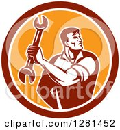 Clipart Of A Retro Muscular Male Mechanic Holding A Wrench In A Red White And Orange Circle Royalty Free Vector Illustration