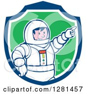 Clipart Of A Cartoon Male Astronaut Pointing In A Blue White And Green Shield Royalty Free Vector Illustration by patrimonio