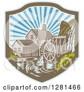 Clipart Of A Retro Woodcut Watermill House At Sunset In A Blue Brown And White Shield Royalty Free Vector Illustration