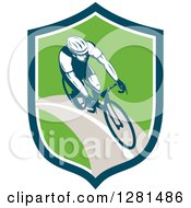 Clipart Of A Retro Male Cyclist In A Blue White And Green Shield Royalty Free Vector Illustration