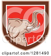 Clipart Of A Cartoon Elephant Head In A Brown White And Red Shield Royalty Free Vector Illustration