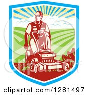 Clipart Of A Retro Woodcut Landscaper Mowing A Lawn With Farmland In A Shield Royalty Free Vector Illustration