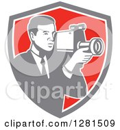 Clipart Of A Retro Professional Cameraman Filming In A Gray White And Red Shield Royalty Free Vector Illustration