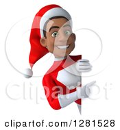 3d Happy Young Black Male Christmas Super Hero Santa Pointing Around A Sign