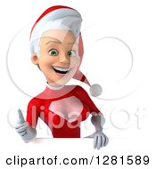 3d Happy Young White Female Christmas Super Hero Santa Holding A Thumb Up Over A Sign