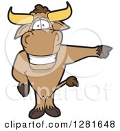 Clipart Of A Happy Bull School Mascot Character Standing And Pointing To The Right Royalty Free Vector Illustration by Toons4Biz