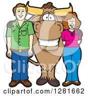 Happy Bull School Mascot Character Standing With A Caucasian Man And Woman by Toons4Biz