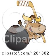 Clipart Of A Happy Bull School Mascot Character Holding An Ice Hockey Stick And Puck Royalty Free Vector Illustration by Toons4Biz