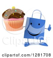 Clipart Of A 3d Happy Blue Shopping Or Gift Bag Character Holding A Thumb Up And A Chocolate Frosted Cupcake Royalty Free Illustration