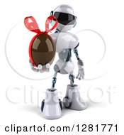 Clipart Of A 3d White And Blue Robot Holding A Chcoolate Easter Egg Royalty Free Illustration