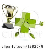 Clipart Of A 3d Unhappy Green Holistic Cross Character Jumping And Holding A Trophy Royalty Free Vector Illustration