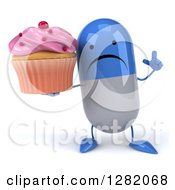 Clipart Of A 3d Unhappy Blue And White Pill Character Holding Up A Finger And A Pink Frosted Cupcake Royalty Free Vector Illustration