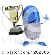 3d Happy Blue And White Pill Character Holding Up A Finger And A Trophy