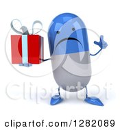 3d Unhhappy Blue And White Pill Character Holding Up A Finger And A Gift