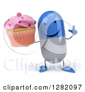 3d Happy Blue And White Pill Character Holding Up A Finger And A Pink Frosted Cupcake