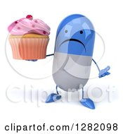 3d Unhappy Blue And White Pill Character Shrugging And Holding A Pink Frosted Cupcake
