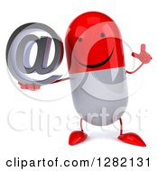 Clipart Of A 3d Happy Red And White Pill Character Holding Up A Finger And An Email Arobase At Symbol Royalty Free Vector Illustration