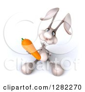 Clipart Of A 3d White Bunny Rabbit Holding Up A Carrot Royalty Free Illustration by Julos