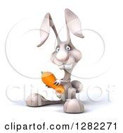 Clipart Of A 3d White Bunny Rabbit Facing Left And Holding A Carrot Royalty Free Illustration by Julos