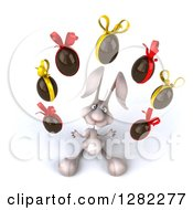 Clipart Of A 3d White Bunny Rabbit Looking Up And Juggling Chocolate Easter Eggs Royalty Free Illustration by Julos