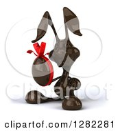 Clipart Of A 3d Dark Chocolate Easter Bunny Holding An Egg Royalty Free Illustration