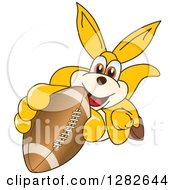 Clipart Of A Happy Kangaroo School Mascot Character Holding Up Or Catching An American Football Royalty Free Vector Illustration by Toons4Biz