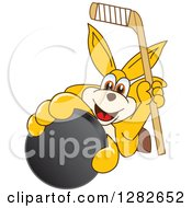 Clipart Of A Happy Kangaroo School Mascot Character Holding Up An Ice Hockey Stick And Puck Royalty Free Vector Illustration by Toons4Biz