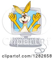 Clipart Of A Happy Kangaroo School Mascot Character Emerging From A Desktop Computer Screen Royalty Free Vector Illustration by Toons4Biz