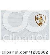 Clipart Of A Retro Mechanic Holding Out A Wrench And Gray Rays Background Or Business Card Design Royalty Free Illustration