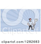 Clipart Of A Cartoon Mechanic With A Giant Wrench And Blue Rays Background Or Business Card Design Royalty Free Illustration