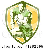 Clipart Of A Retro Male Rugby Player Running In A Green White And Yellow Shield Royalty Free Vector Illustration