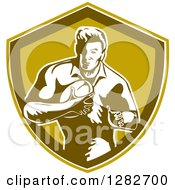Clipart Of A Retro Male Rugby Player Running In A Green And White Shield Royalty Free Vector Illustration
