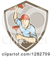 Poster, Art Print Of Retro Cartoon Male Plumber With A Monkey Wrench And A Plunger In A Brown And White Shield