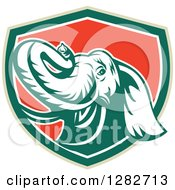 Clipart Of A Retro Angry Elephant In A Green White And Red Shield Royalty Free Vector Illustration