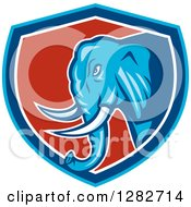 Clipart Of A Cartoon Angry Elephant In A Blue White And Red Shield Royalty Free Vector Illustration