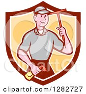 Clipart Of A Retro Cartoon Male Window Washer Holding A Spray Bottle And Squeegee In A Brown White And Yellow Shield Royalty Free Vector Illustration