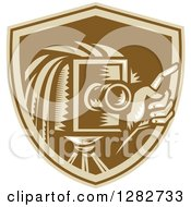 Clipart Of A Retro Woodcut Male Photographer Holding Up A Finger And Using A Vintage Camera In A Brown Shield Royalty Free Vector Illustration