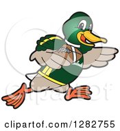 Clipart Of A Happy Mallard Duck School Sports Mascot Character Running With An American Football Royalty Free Vector Illustration