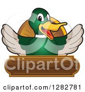 Happy Mallard Duck School Mascot Character Welcoming Over A Wooden Sign